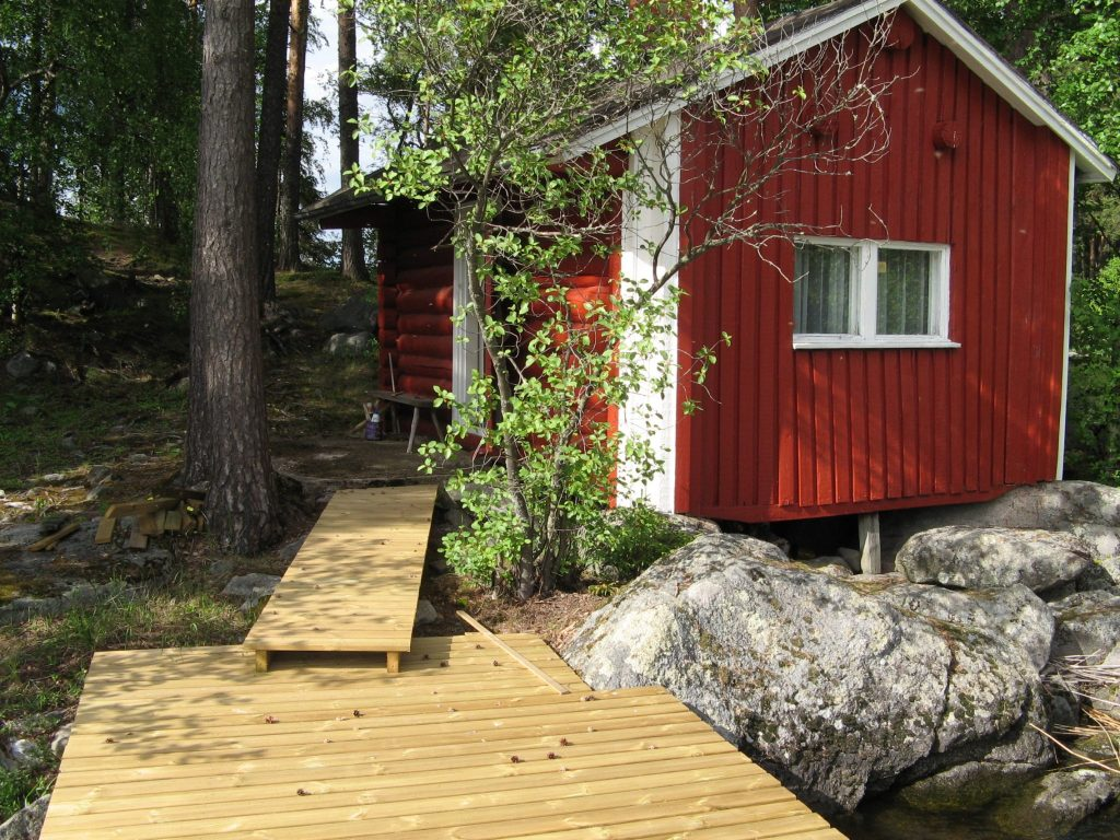 Red cottage in forest, Finland