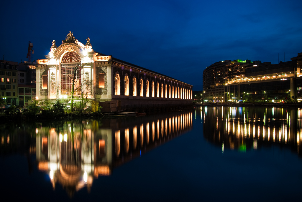 City lights and museum mirroring the lake