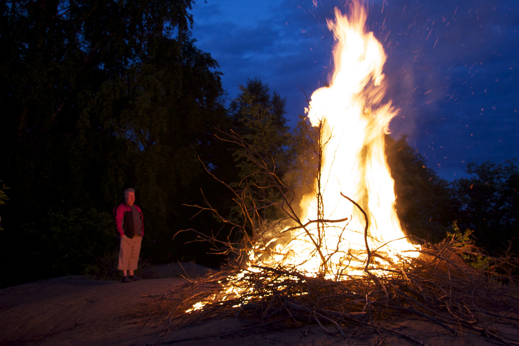 Woman standing in front of a bonfire