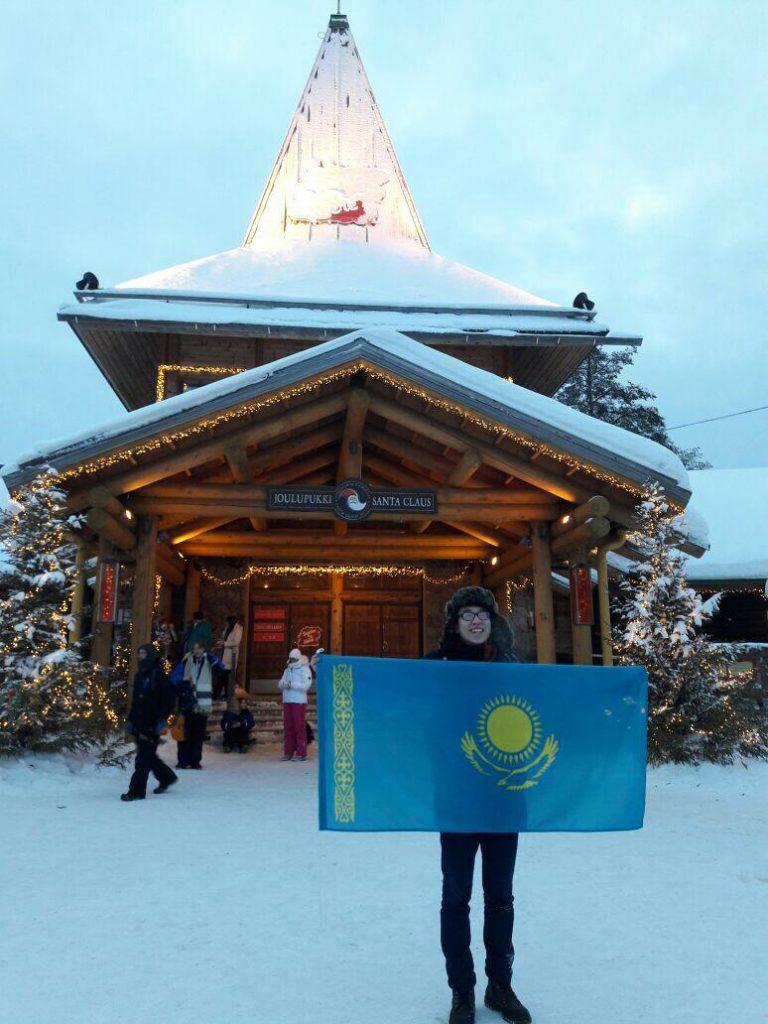 Student visiting Santa Claus in Lapland