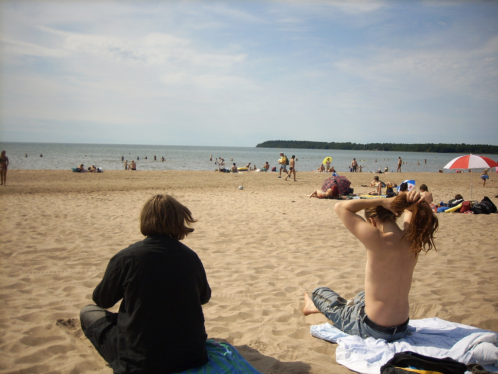 People enjoying a summer day at a beach in Finland