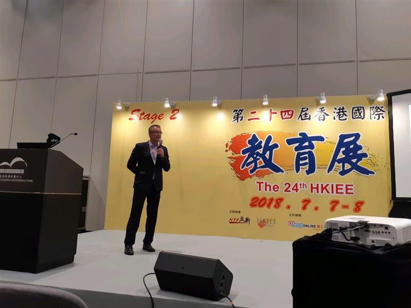 Man giving speech in a study exhibit in HK