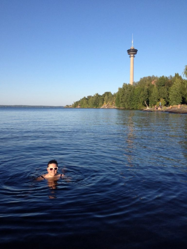 lady swimming in Finland lake
