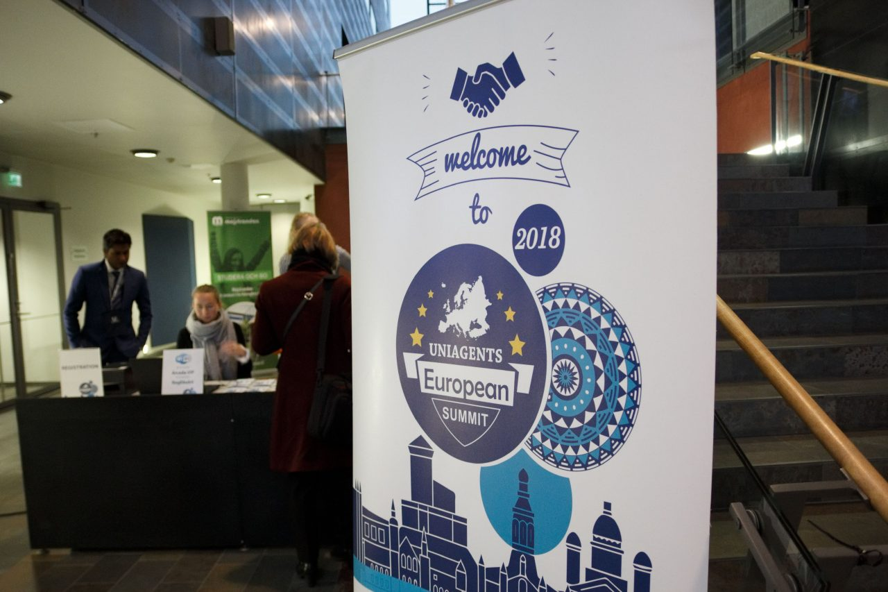 The info desk and poster for the Uniagents European Summit in Helsinki, Finland