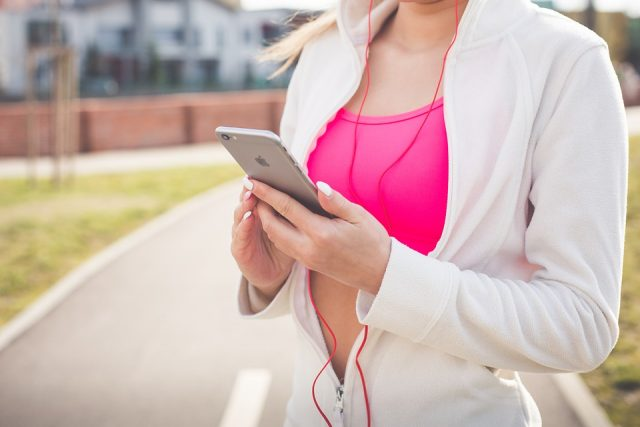Woman working out and exercising with a smartphone