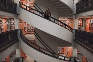 A girl standing in the middle of a spiral staircase