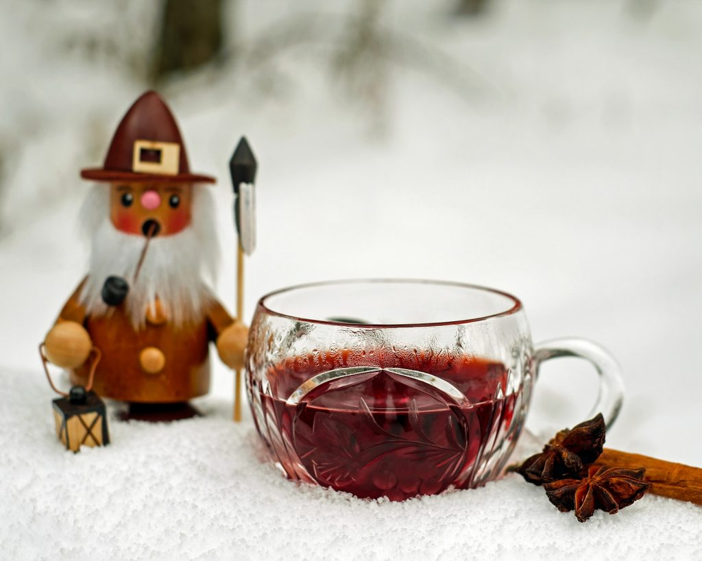 finnish christmas foods glass cup of warm glögi on white background
