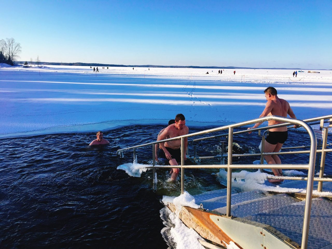 swimming in iced lake in Finland