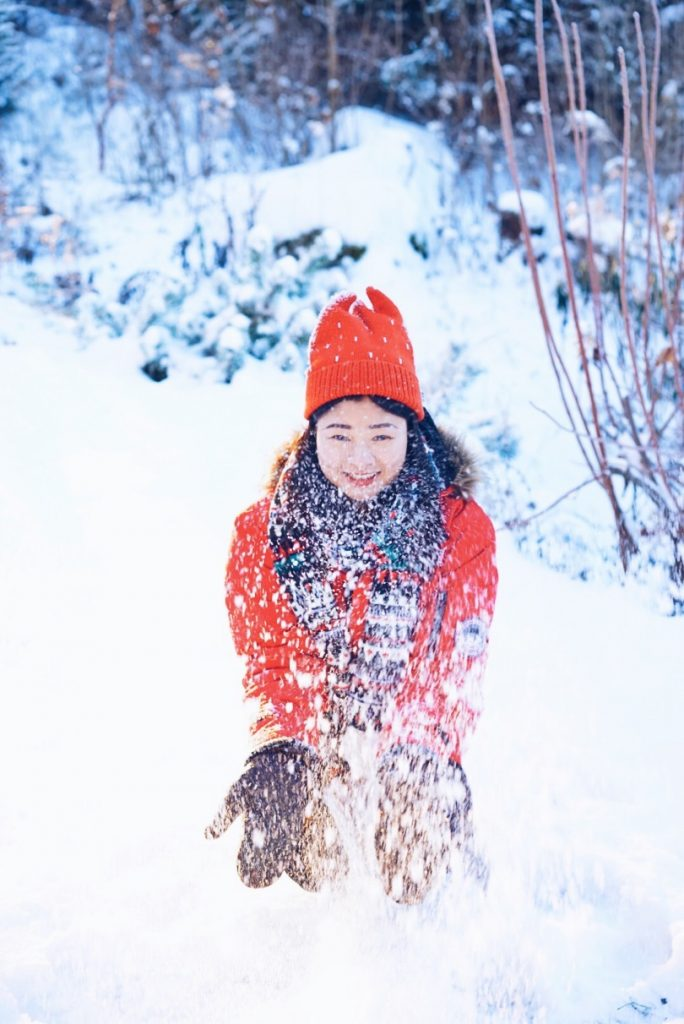 Young student playing in snow