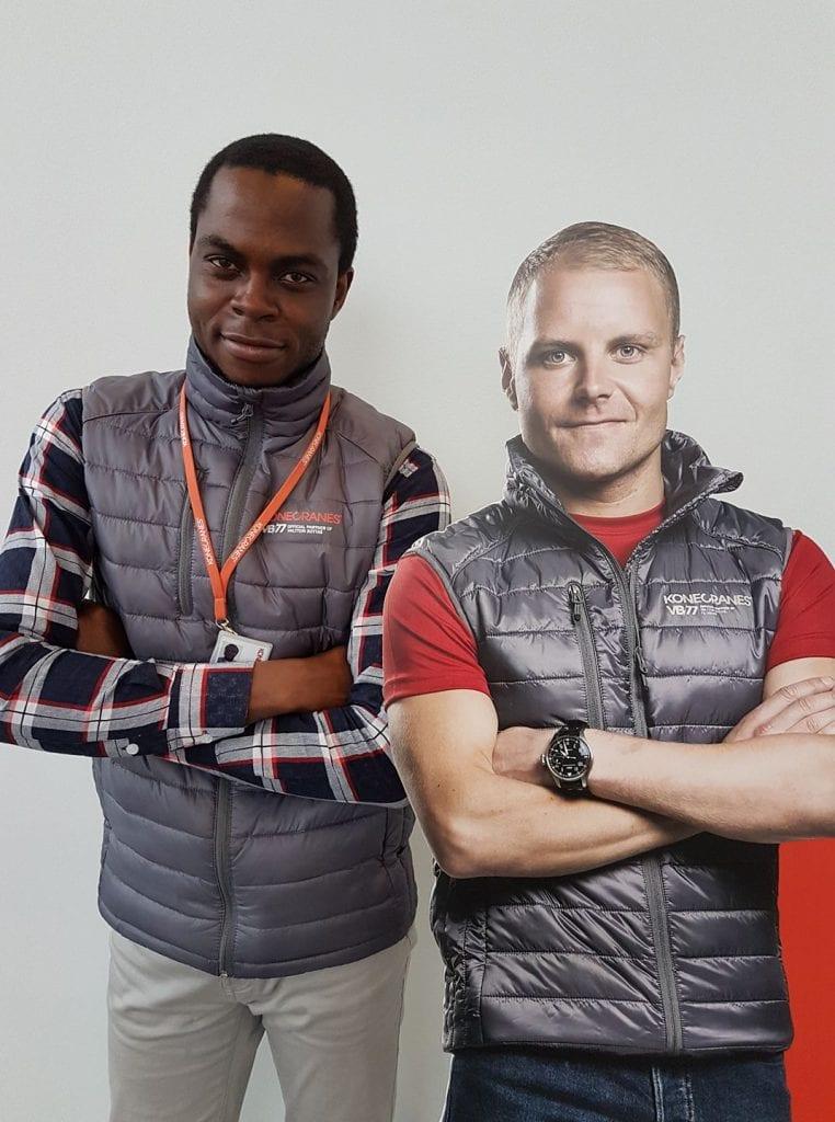 international student next to cardboard cutout
