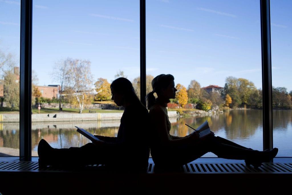 Metropolia students next to campus window
