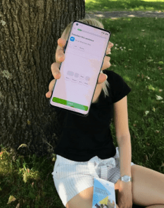 Finnish student holding a mobile phone Duolingo