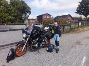 Foreign student on her motorbike road trip trekking