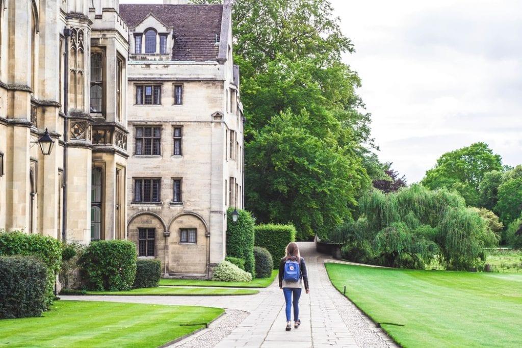 girl walking in a university campus