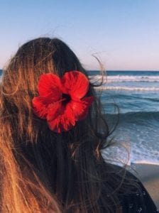 A girl with a flower on her hair