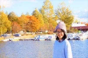 Lady lakeside autumn season