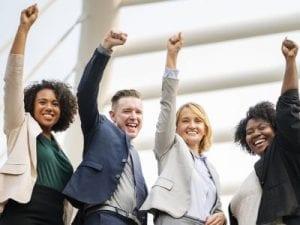 Happy employees raising hands