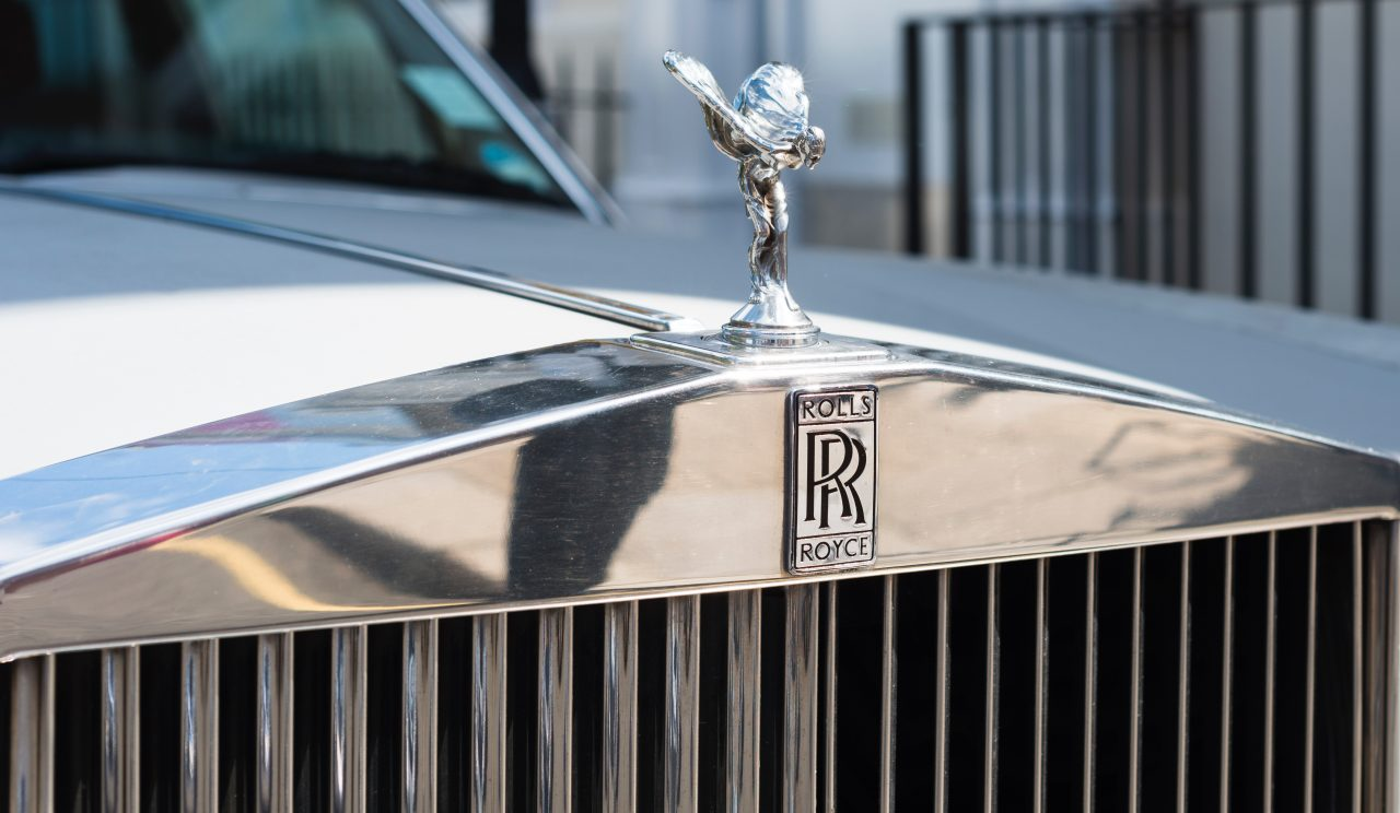 close up photography of silver Rolls-Royce emblem