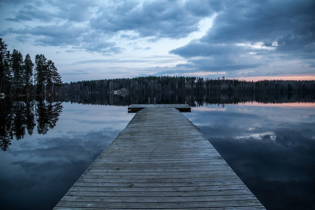a dock by a lake in finland