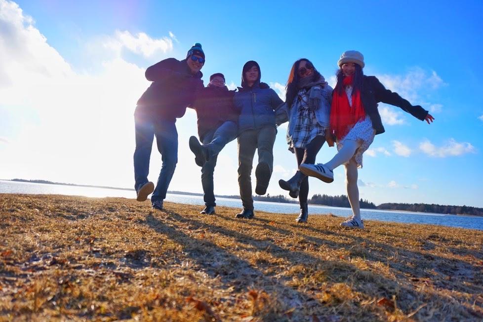 Five happy people outdoors