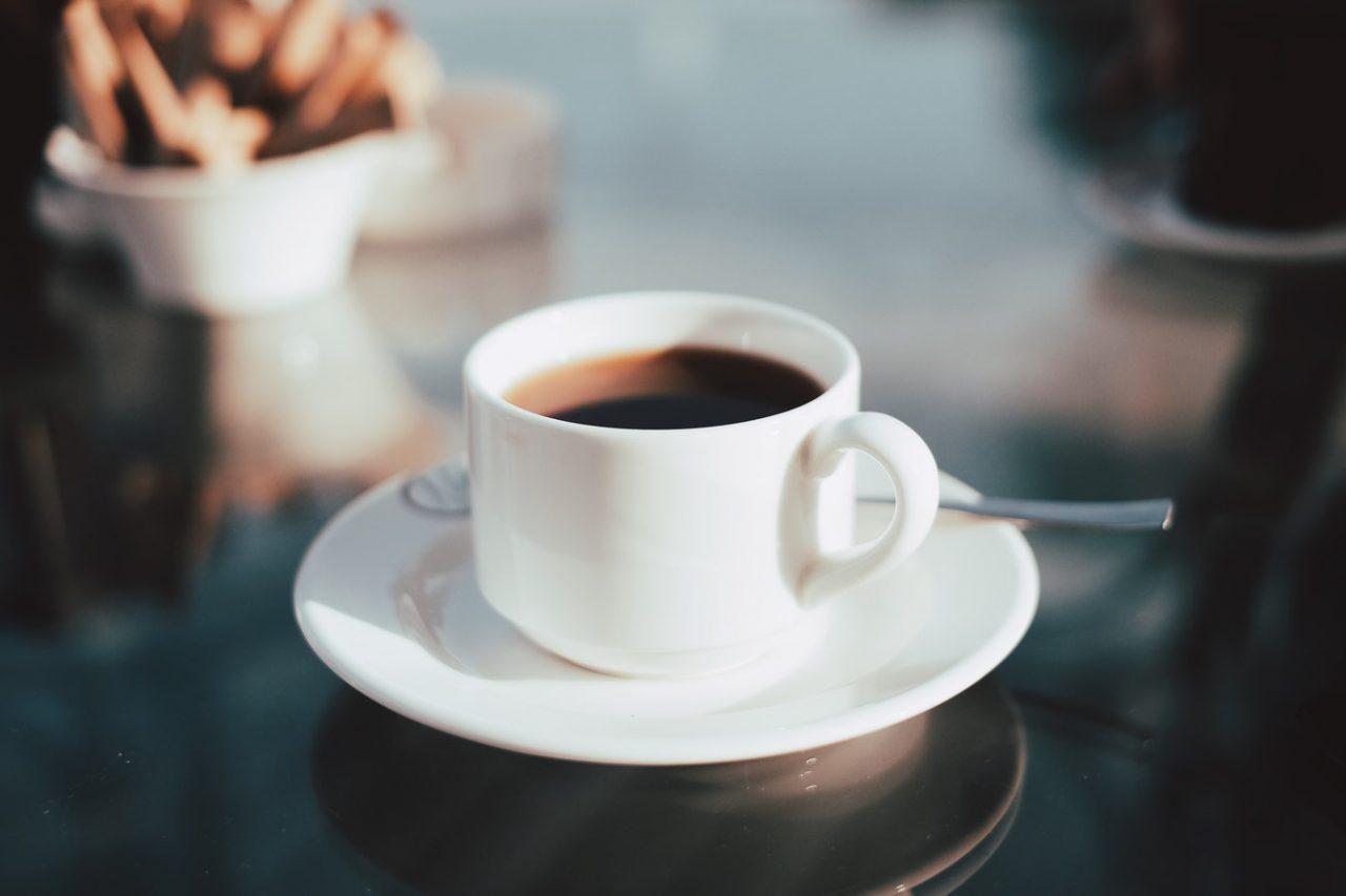 helsinki café focus on white mug of black coffee