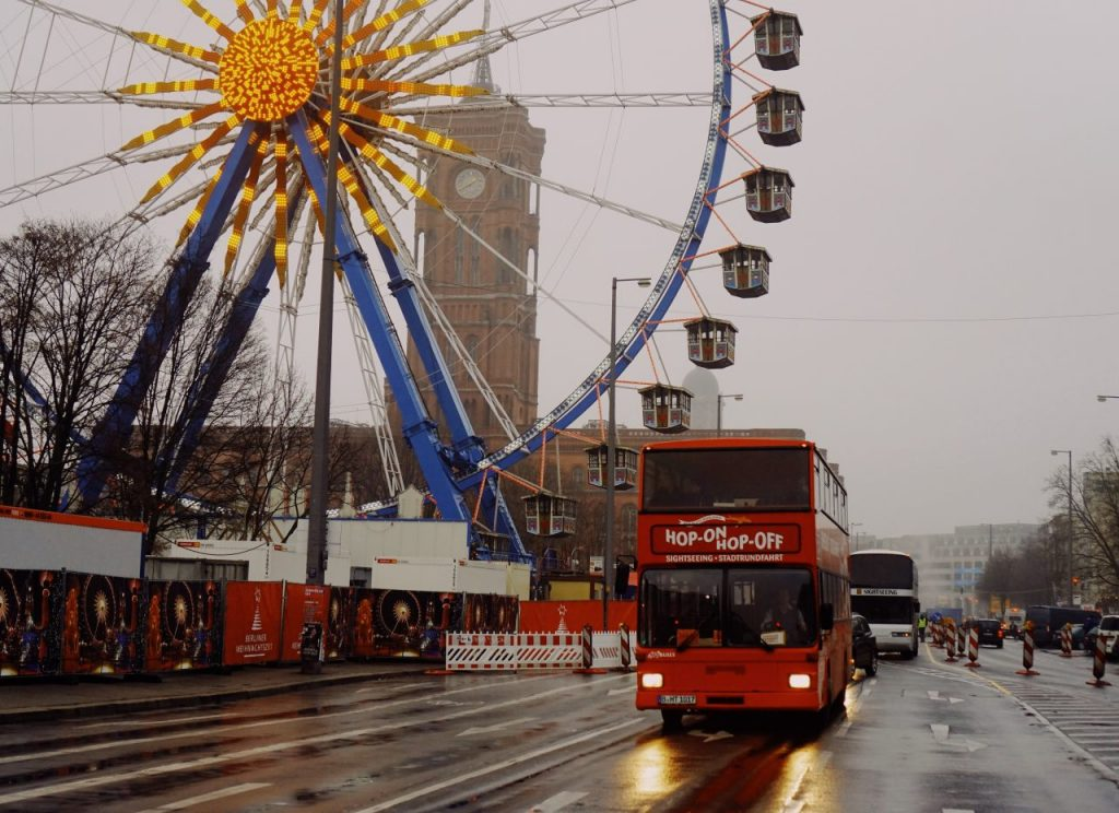 Hop-On Hop-Off bus is a red double decker bus and drives around the Helsinki center