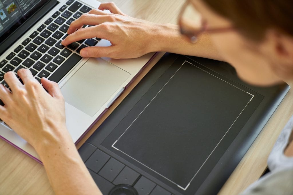 a woman works on a computer