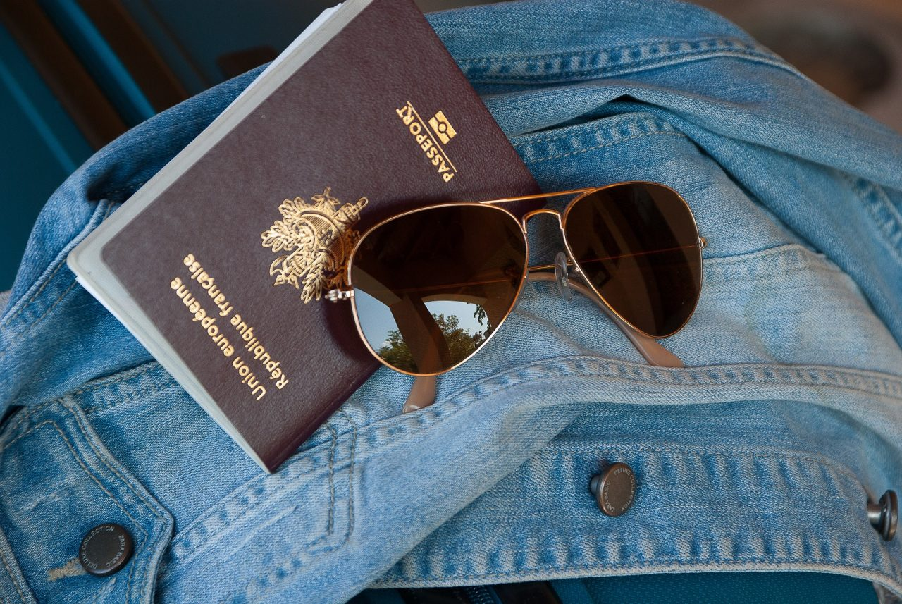 Denim jacket, sunglasses and a passport