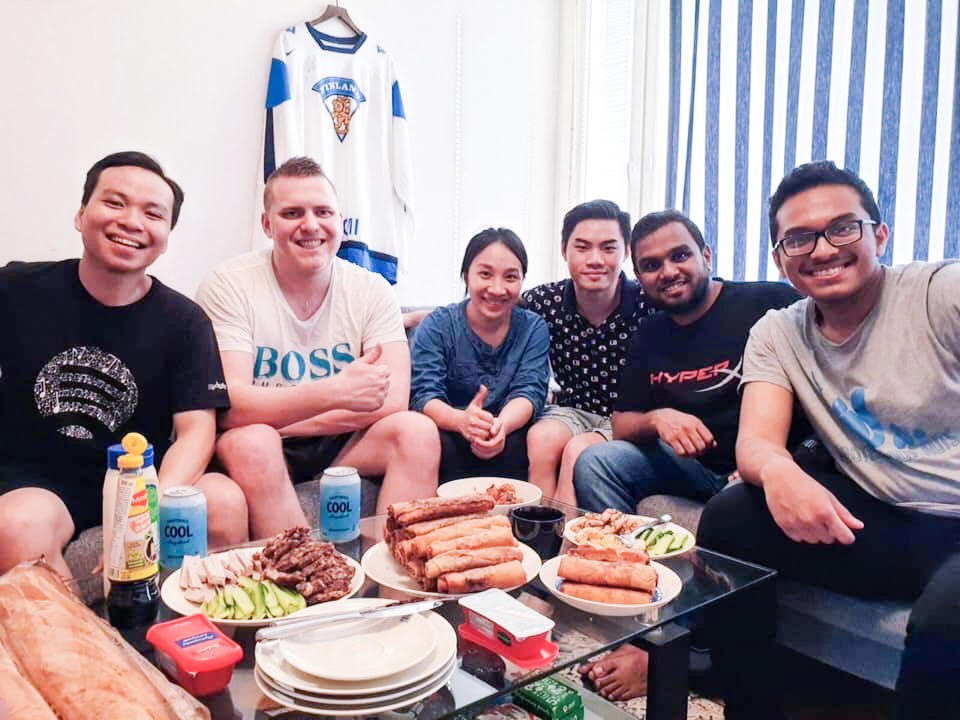 International friends having meal together with Vietnamese food