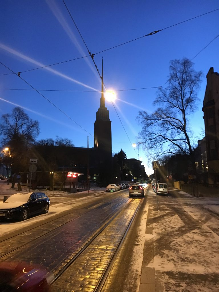 Wet roads in Finland with cars during evening