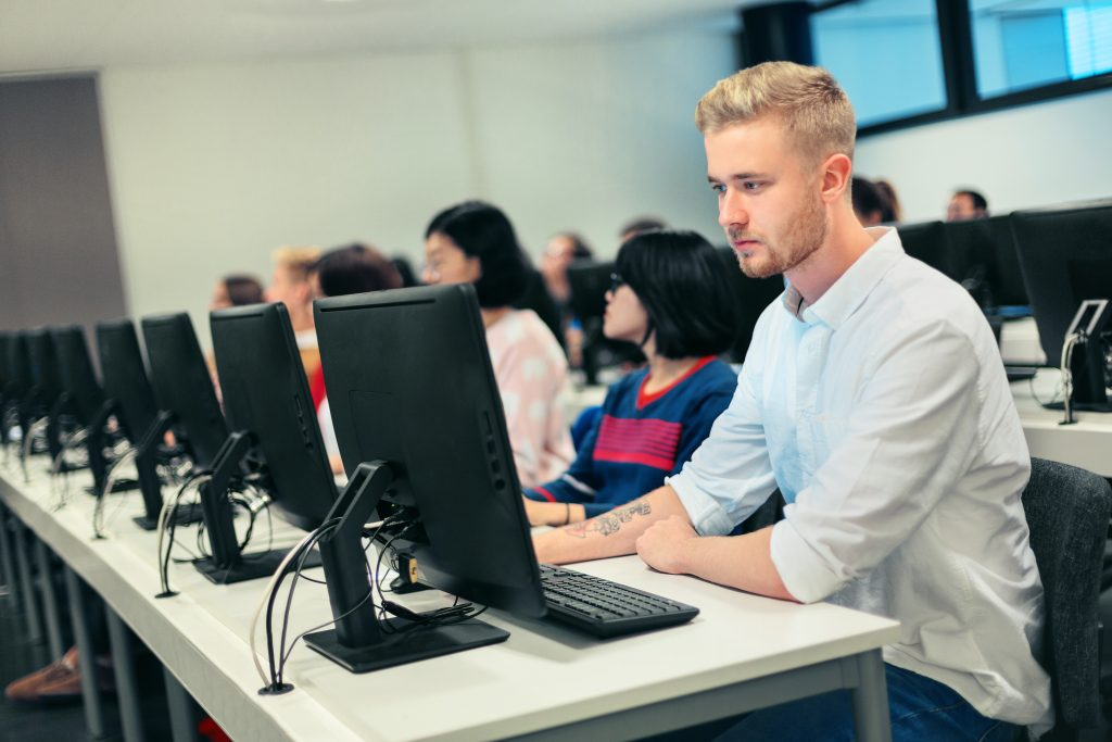 Student sitting in a computer lab in Finland, Europe