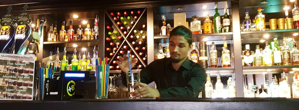 Nepalese student in Finland working, serving drinks