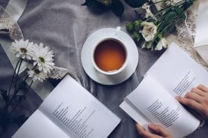 Books and a teacup with some flowers