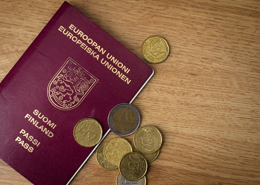 European passport and coins on the table