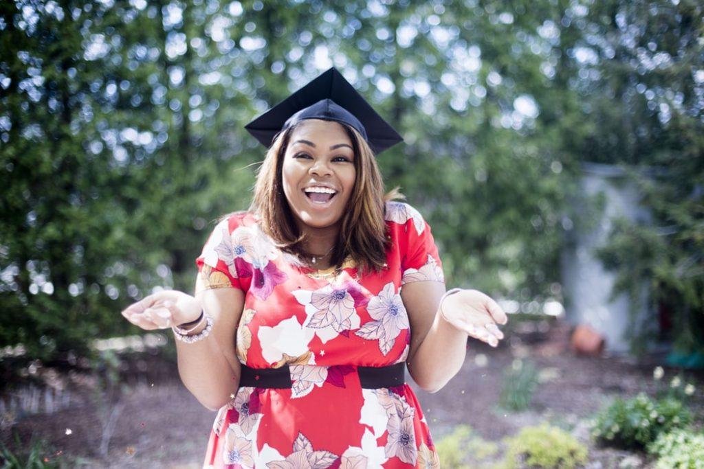 A happy student with a graduation cap