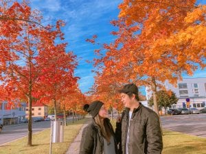 Lovely couple with autumn leaves on background
