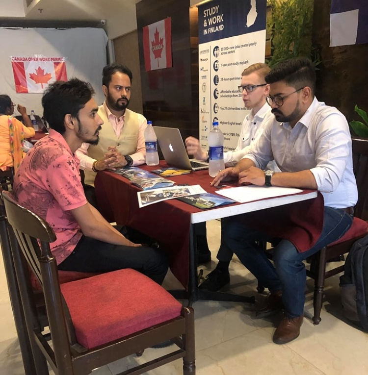 Working people on a discussion with Canada Flag