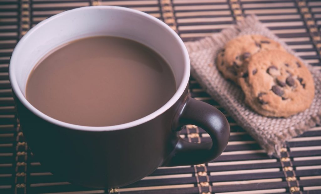A cup of coffee and a few cookies