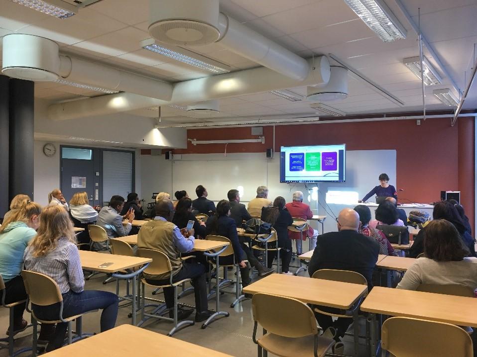 Foreign delegates listening to a presentation in class room in Hämeenlinna high school, Finland