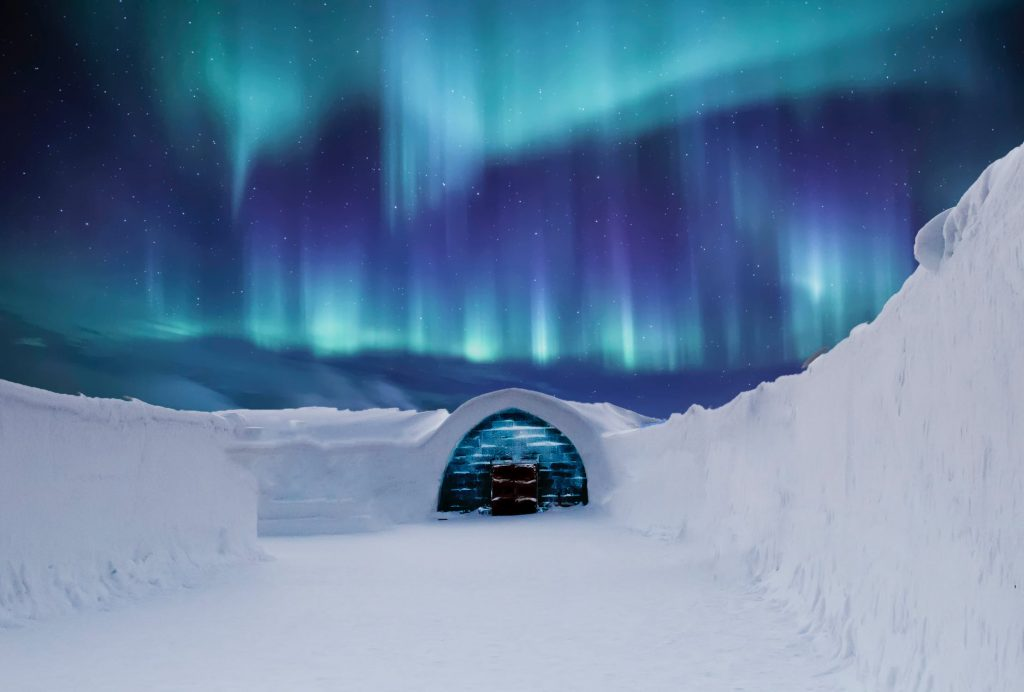 Snow house, norther lights above the sky