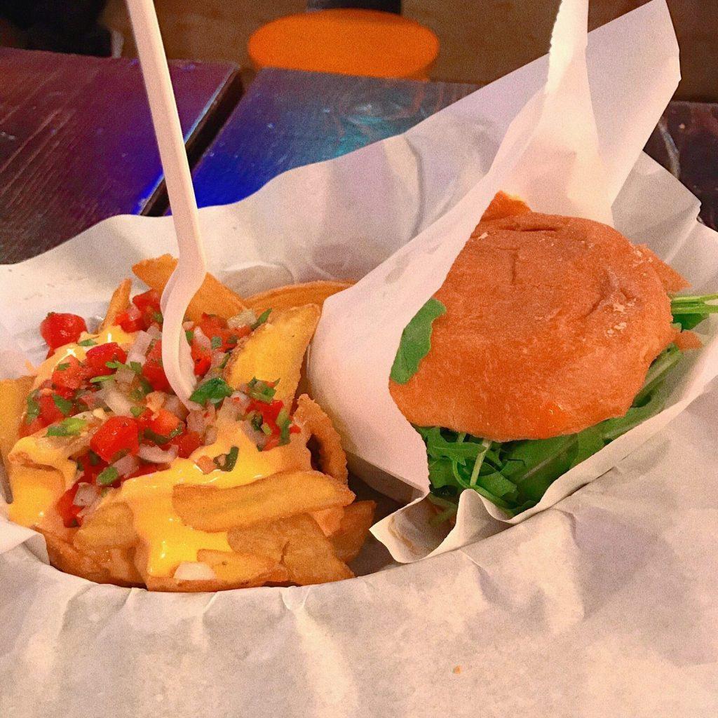 A hamburger and fries street food