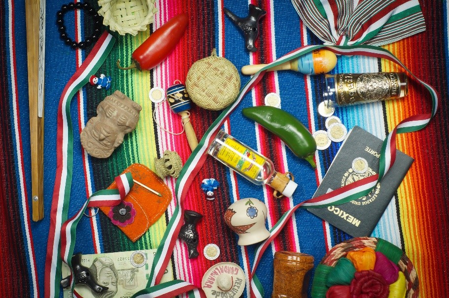 passport, peppers, small statues, and other miscellaneous items on a colour colour rug