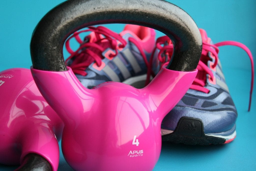 dumbbell and work out shoes against blue background