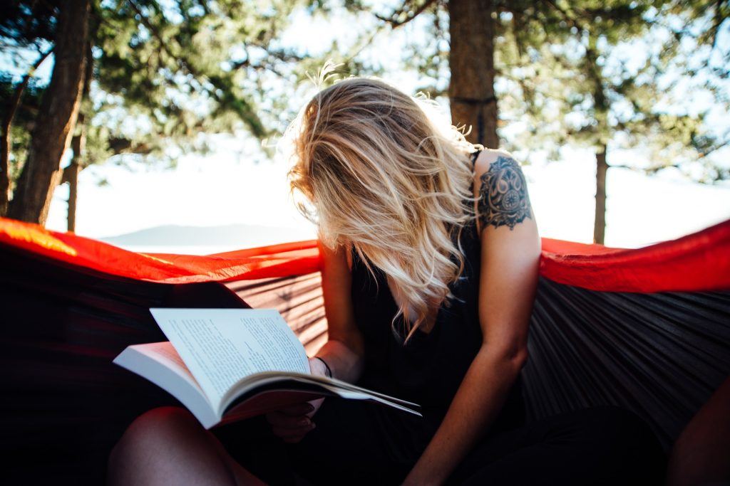 Student reading in Finland in a hammock