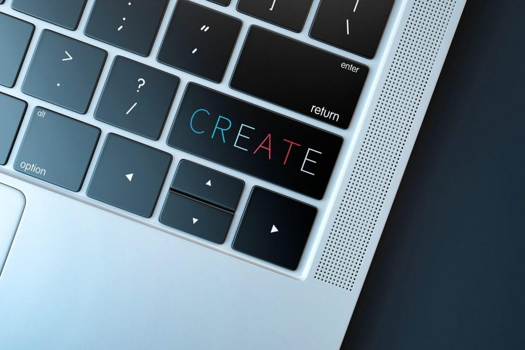 Apple computer keyboard with the text: create.