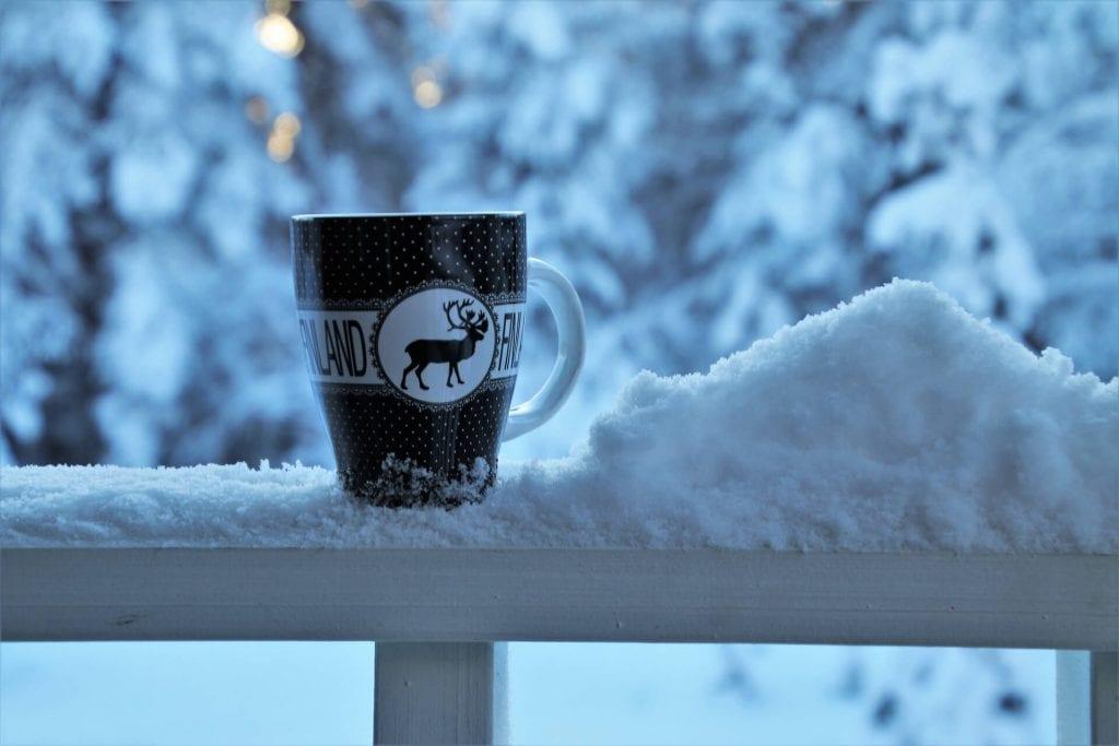 Reindeer coffee mug in the snow
