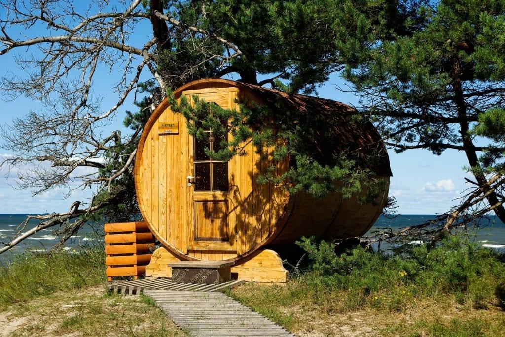 Barrel sauna by a lake in Finland