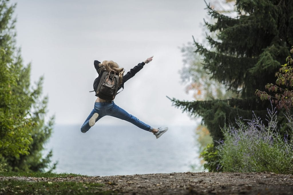 Girl jumping in the air in nature